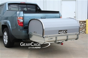 How do you overcome the blocking of the license plate on the parent vehicle, using this cargo carrier?