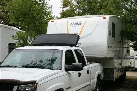 I have a 2017 Chevy Express 3500 - it has been modified and has external rain gutters- can I attach to this Wind Deflector?